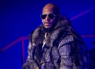NEW YORK, NY - DECEMBER 17: Singer R. Kelly performs in concert during the '12 Nights Of Christmas' tour at Kings Theatre on December 17, 2016 in the Brooklyn borough New York City.