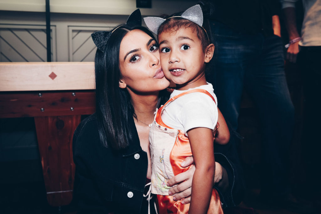 INGLEWOOD, CA - MARCH 31:  In this handout photo provided by Forum Photos,  Among the VIP guests of Managing Partner, Shelli Azoff, and Ariana Grande's manager, Scooter Braun, in the exclusive Forum Club enjoying the Ariana Grande Dangerous Woman show at the Forum were Kim Kardashian and daughter, North West on March 31, 2017 in Inglewood, California.
