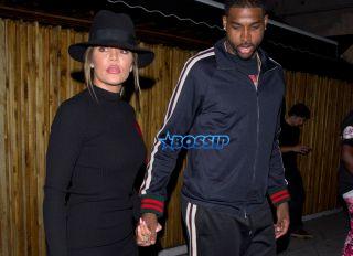 Khloe Kardashian a short black dress, knee high boots and a black hat was NBA Basketball player boyfriend Tristan Thompson 'The Nice Guy' bar in West Hollywood, CA SPW / Splash News