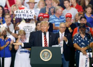 PHOENIX, AZ - AUGUST 22: U.S. President Donald Trump gestures to the crowd as he speaks to supporters at the Phoenix Convention Center during a rally on August 22, 2017 in Phoenix, Arizona.