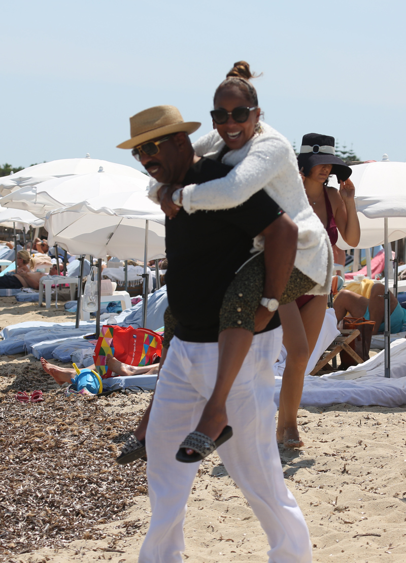 Comedian Steve Harvey relaxes with his wife Marjorie Bridges Woods on holiday in Club 55 in Saint-Tropez, France.