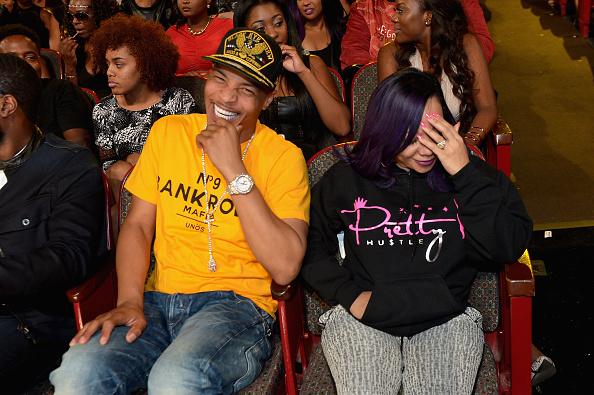 "ATLANTA, GA - OCTOBER 09: T.I. (L) and Tameka ""Tiny"" Cottle-Harris enjoy the BET Hip Hop Awards Show 2015 at the Atlanta Civic Center on October 9, 2015 in Atlanta, Georgia."