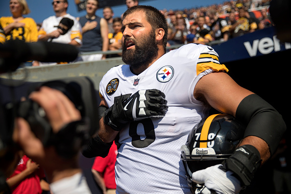 Pittsburgh Steelers offensive tackle Alejandro Villanueva (78) is the sole member of the team to stand in the open for the national anthem while his teammates remained in the tunnel before a game against the Chicago Bears on Sunday, Sept. 24, 2017, at Soldier Field in Chicago, Ill.