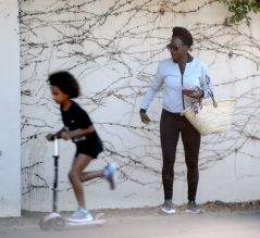 Viola Davis takes a stroll with her daughter Genesis, who is riding a scooter, in the Toluca Lake neighbourhood of Los Angeles, California.
