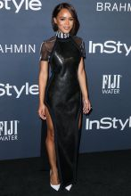Actress Serayah McNeill wearing a Versus Versace dress and John Hardy jewelry arrives at the InStyle Awards 2017 held at the Getty Center on October 23, 2017 in Los Angeles, California, United States.