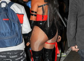 French Montana and La La Anthony pose while arriving at La La Anthony's Halloween party at TAO in New York City, New York.