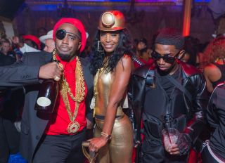 NOVEMBER 01: Rapper Diddy (Sean Combs), Kim Porter and son Christian Casey Combs attend the 90's Halloween Party at Joseph's Cafe on November 1, 2017 in Hollywood, Los Angeles, California, United States.