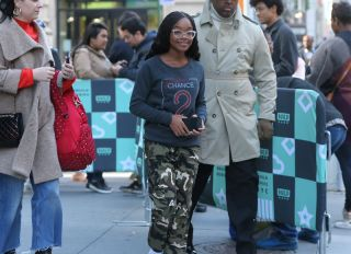 Actress Marsai Martin flashes the peace sign as she leaves AOL Build Series in New York City,