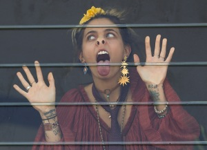 Paris Jackson is seen flirting with an unknown man at the Melbourne Cup.
