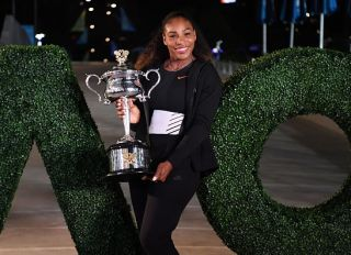 Serena Williams of the US poses with the championship trophy after her victory against Venus Williams of the US in the women's singles final on day 13 of the Australian Open tennis tournament in Melbourne on January 29, 2017. / AFP / SAEED KHAN / IMAGE RESTRICTED TO EDITORIAL USE - STRICTLY NO COMMERCIAL USE
