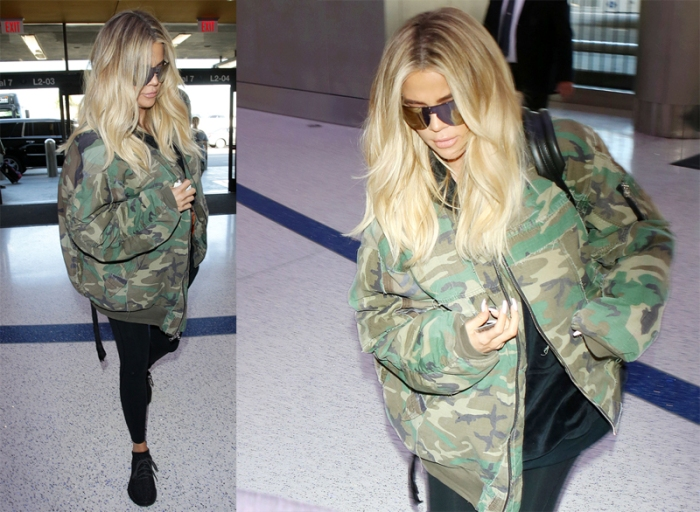 Klhoe Kardashian arriving at LAX wearing oversize camo jacket