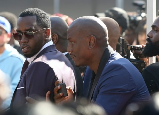 Sean Diddy Combs and Tyrese Gibson having fun at Mary J. Blige star ceremony in Los Angeles, California