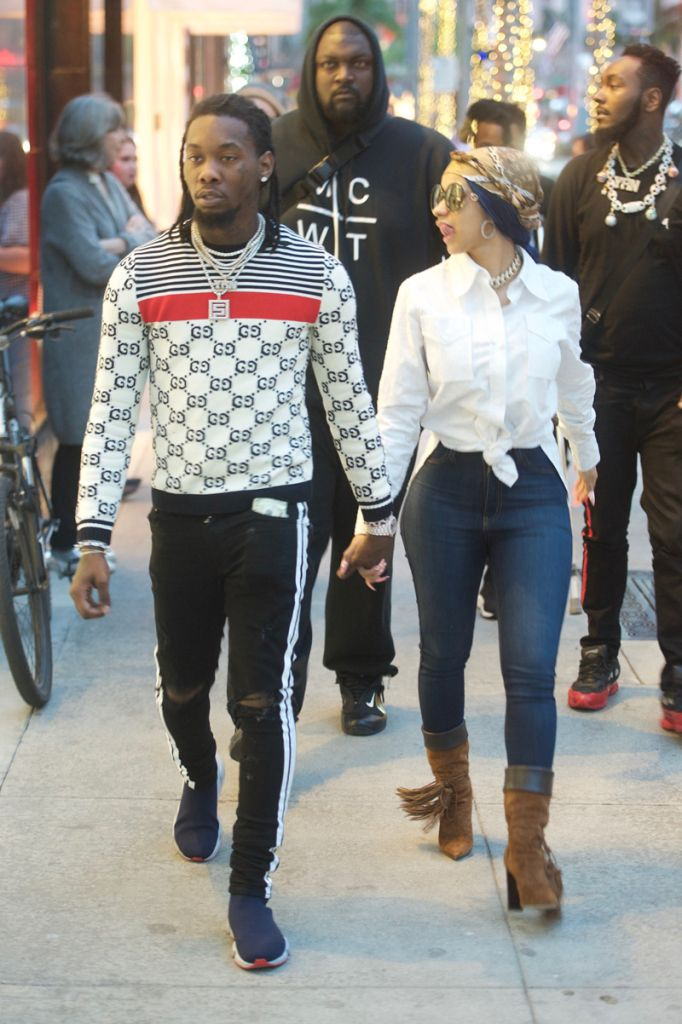 Cardi B and Off Set walk hand in hand as they shop together at Moncler on Rodeo Drive in Beverly Hills