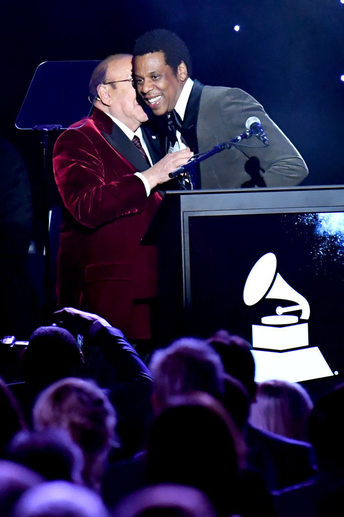 NEW YORK, NY - JANUARY 27:  Host Clive Davis (L) presents the President's Merit Award to honoree Jay-Z onstage during the Clive Davis and Recording Academy Pre-GRAMMY Gala and GRAMMY Salute to Industry Icons Honoring Jay-Z on January 27, 2018 in New York City.