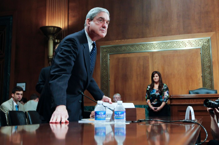 Russia Probe Robert Mueller chats with senators prior to testifying before the Senate Judiciary Committee Hearing on oversight of the Federal Bureau of Investigation.