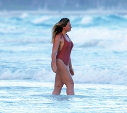 Iskra Lawrence in a one piece bathing suit while the beach in Tulum Mexico.