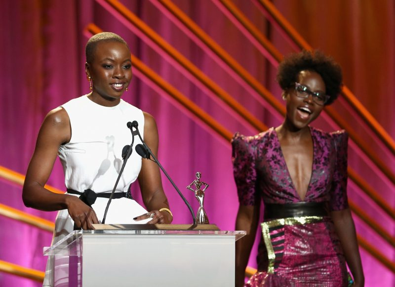 BEVERLY HILLS, CA - MARCH 01: Honoree Danai Gurira (L), and Presenter Lupita Nyong'o speak onstage during the 2018 Essence Black Women In Hollywood Oscars Luncheon at Regent Beverly Wilshire Hotel on March 1, 2018 in Beverly Hills, California.