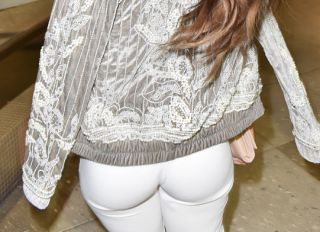 model, Daphne Joy who is 50 Cent's baby mama, showed her enviable curvy figure as she headed out for dinner in Miami wearing a tiny white sports bra, matching white pants and heels.