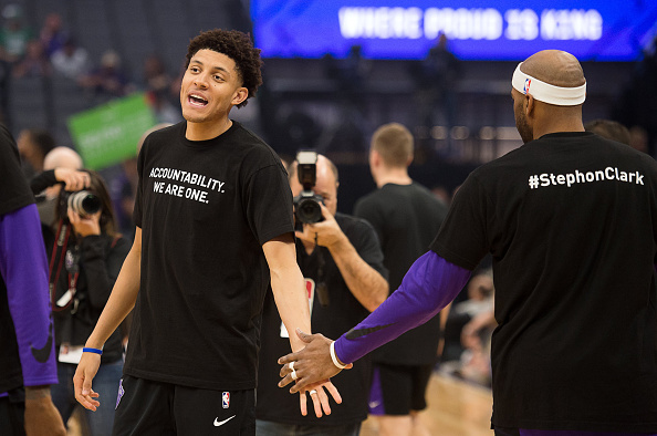 "Sacramento Kings forward Justin Jackson (25) slaps hands with Sacramento Kings guard Vince Carter (15) as they wear T-shirts bearing the name of Stephon Clark during a game at Golden 1 Center on Sunday March 25, 2018 in Sacramento, Calif. The Kings and Celtics wore shirts bearing the name of the unarmed man, Stephon Clark, who was killed by Sacramento police. The black warm-up shirts have ""Accountability. We are One"" on the front and ""Stephon Clark"" on the back."