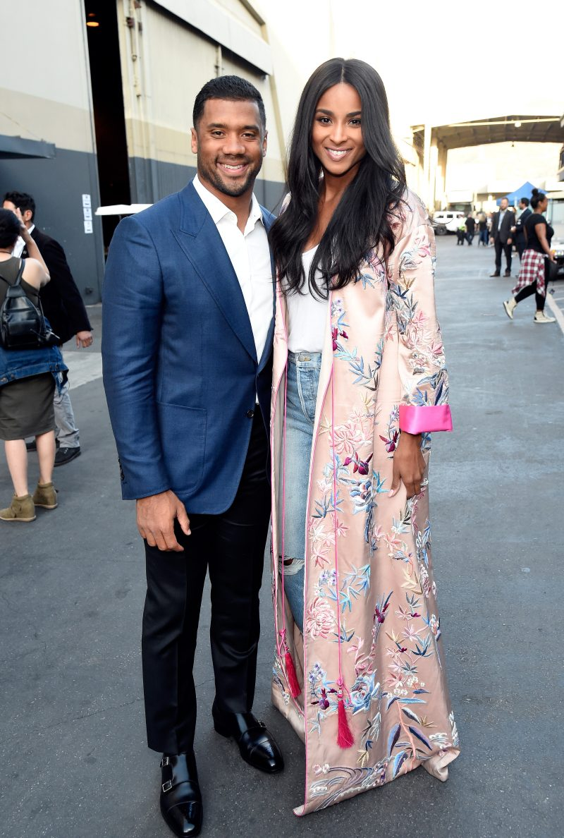 """LOS ANGELES, CA - OCTOBER 14:  In this handout photo provided by One Voice: Somos Live!, NFL player Russell Wilson and singer Ciara pose backstage during """"One Voice: Somos Live! A Concert For Disaster Relief"""" at the Universal Studios Lot on October 14, 2017 in Los Angeles, California."""