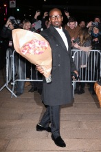 Actor Jamie Foxx, carrying a dozen roses, attends Dolce & Gabbana Alta Moda at Lincoln Center in New York City, New York on April 8, 2018.