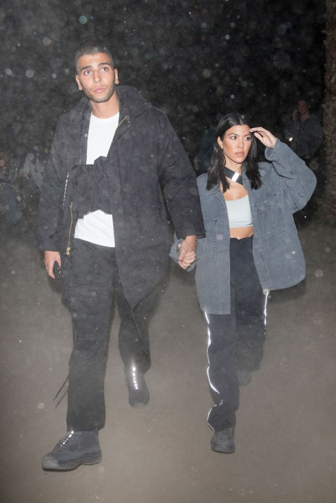 Kourtney Kardashian and boyfriend Younes Bendjima are both seen arriving to the Neon Carnival during Coachella Weekend.