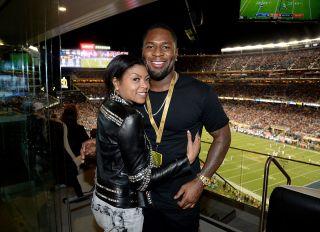 SANTA CLARA, CA - FEBRUARY 07: Actress Taraji P. Henson (L) and NFL player Kelvin Hayden attend Super Bowl 50 at Levi's Stadium on February 7, 2016 in Santa Clara, California.