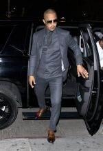 T.I. Rapper T.I looked dapper in a grey suit and sunglasses as he was seen arriving to Stevie Wonders early Birthday and a Song party at Peppermint Night club in West Hollywood, CA