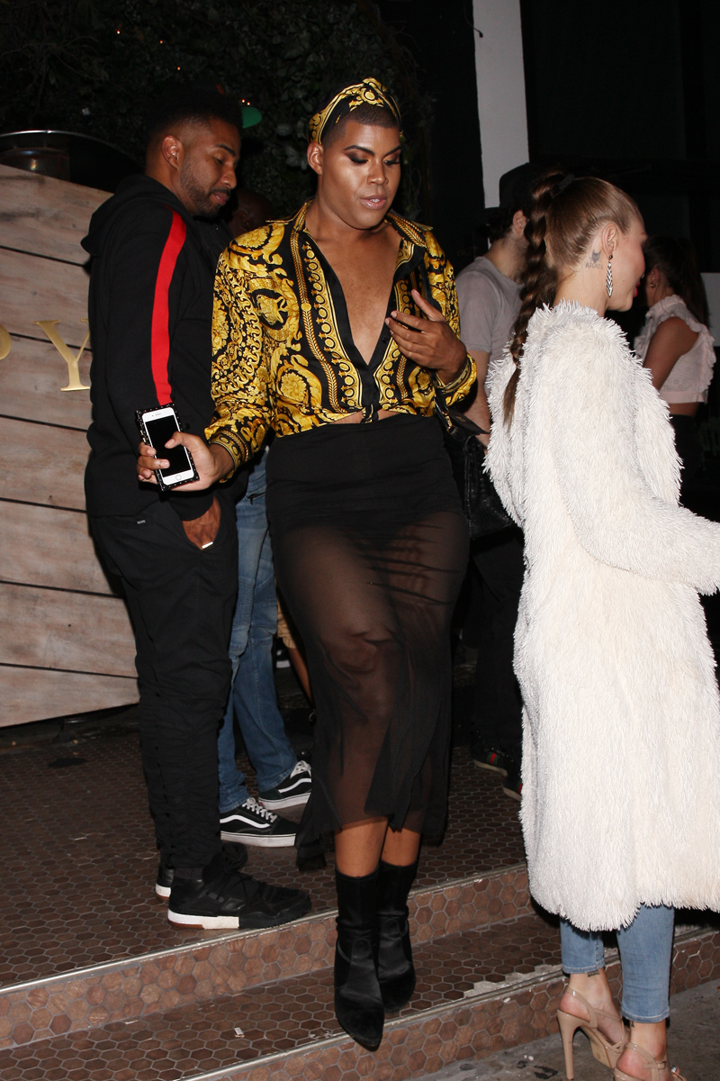 EJ Johnson wears a Versace shirt as he is seen exiting the Poppy club after a night of partying in West Hollywood
