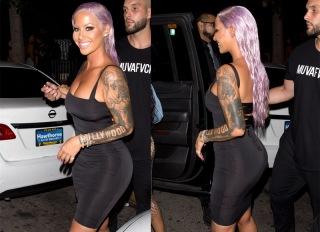 Amber Rose shows off her new Purple hair Style in a LBD as she was seen leaving 'Ace of Diamonds' strip club in West Hollywood, CA