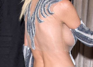 Actress Tara Reid seen at Delilah Night Club dressed in a Silver colored designer evening gown holding on the arm of her boyfriend. Tara has recently been promoting her latest installment of the movie 'Sharknado'