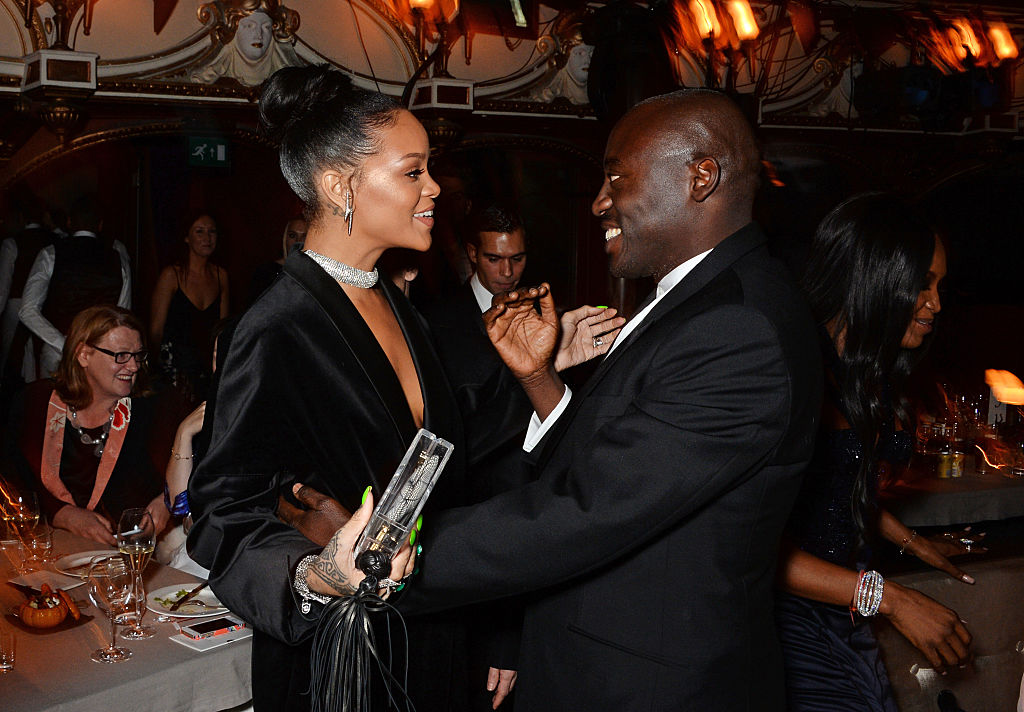 LONDON, ENGLAND - DECEMBER 01:  Rihanna (L) and Edward Enninful attend a drinks reception at the British Fashion Awards at the London Coliseum on December 1, 2014 in London, England.
