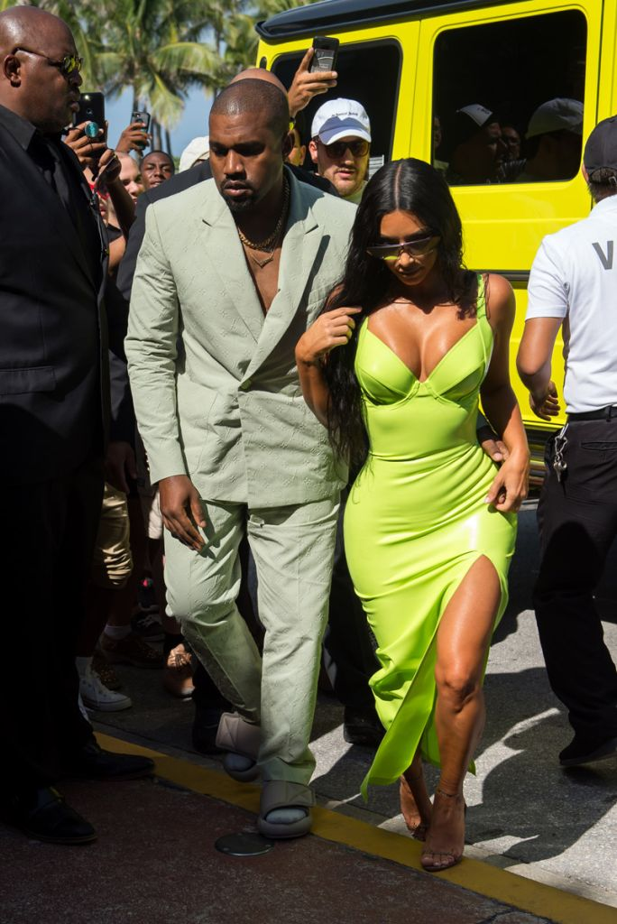 Kim Kardashian neon gown as she and Kanye West arrive at Miami's Versace Mansion for rapper 2Chainz Wedding on Saturday (aug 18).