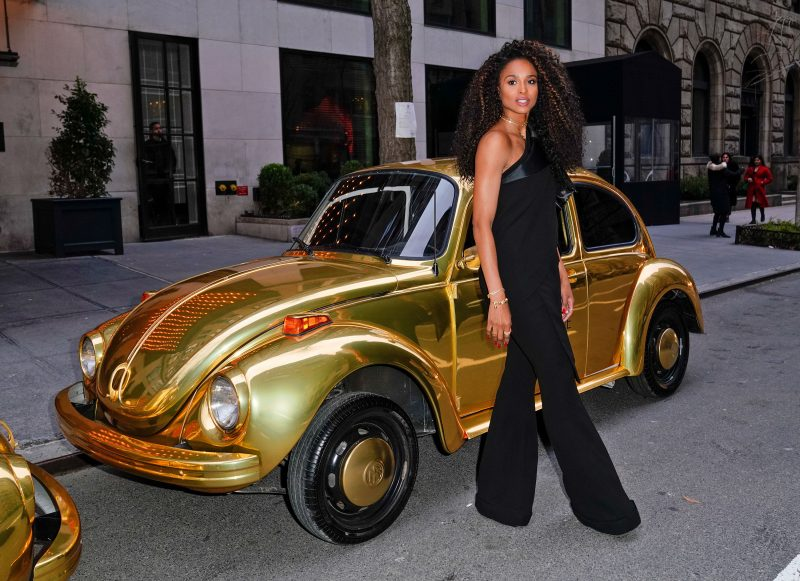Ciara poses for photos in front of dual gold VW Beetles at Pandora Jewelry Shine collection launch in New York