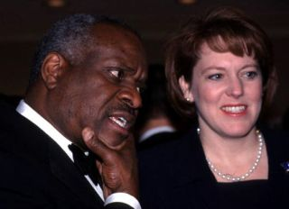 F365441 02: Supreme Court Justice Clarence Thomas and wife Virginia attend the American Enterprise Institute's annual dinner, February 15, 2000 in Washington, DC.