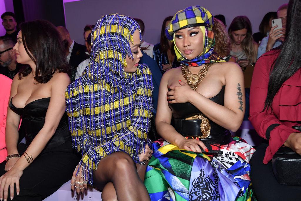 MILAN, ITALY - SEPTEMBER 21: Rita Ora and Nicki Minaj attend the Versace show during Milan Fashion Week Spring/Summer 2019 on September 21, 2018 in Milan, Italy.