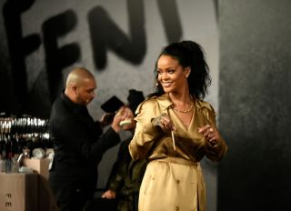 """DUBAI, UNITED ARAB EMIRATES - SEPTEMBER 29: Rihanna walks on stage during her Fenty Beauty talk in collaboration with Sephora, for the launch of her new Stunna Lip paint """"Uninvited"""" on September 29, 2018 in Dubai, United Arab Emirates."""