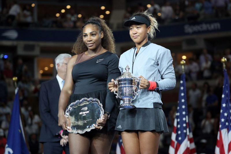 Tennis players Naomi Osaka and Serena Williams hold their respective trophies during the trophy presentation ceremony for the Women's singes title at the 2018 U.S. Open in New York, NY.