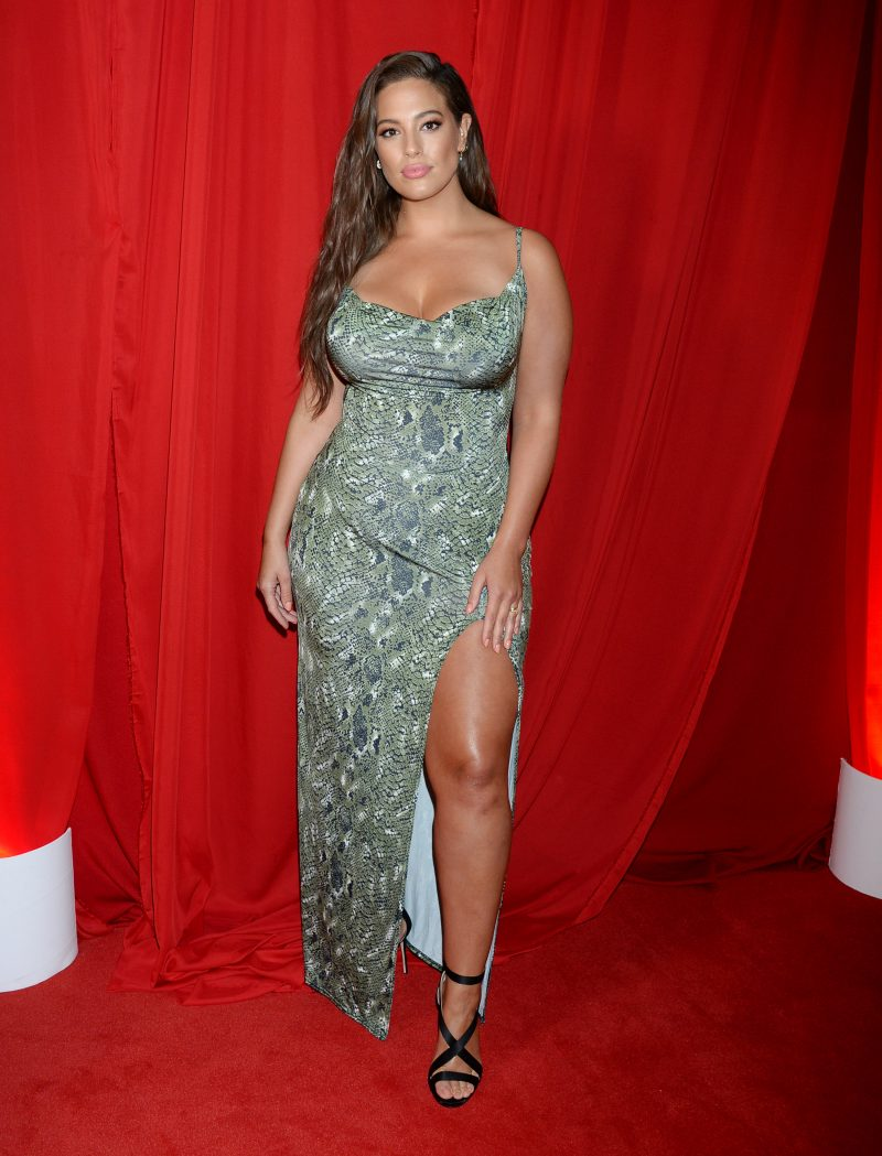 Celebrities, including Ashley Graham in a green animal print dress, are seen attending the 'PrettyLittleThing x Ashley Graham' collaboration event at Delilah Nightclub in Los Angeles, CA.