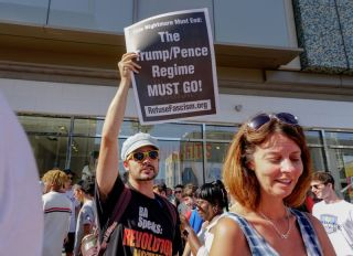 Protesters at the scene after U.S President Donald Trump 's Hollywood Walk of Fame star was vandalized by a man with a pickaxe overnight.