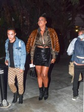 EJ Johnson wearing Fendi fur jacket and blouse with patent leather mini skirt and booties in Los Angeles, CA.