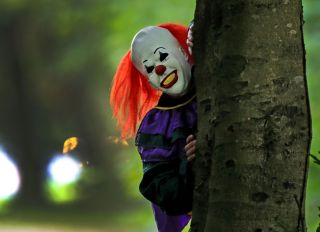 POSED BY MODEL A person wearing a clown costume in Liverpool, as reviews for the film adaptation of Stephen King's It are in, with critics predicting the movie will leave a whole new audience terrified of clowns