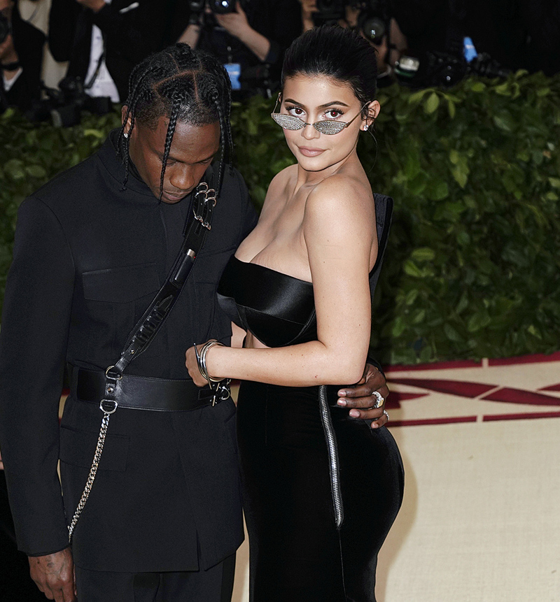 Kylie Jenner and Travis Scott at 2018 Met Gala celebrating the exhibition 'Heavenly Bodies: Fashion and the Catholic Imagination' at the Metropolitan Museum of Art in New York