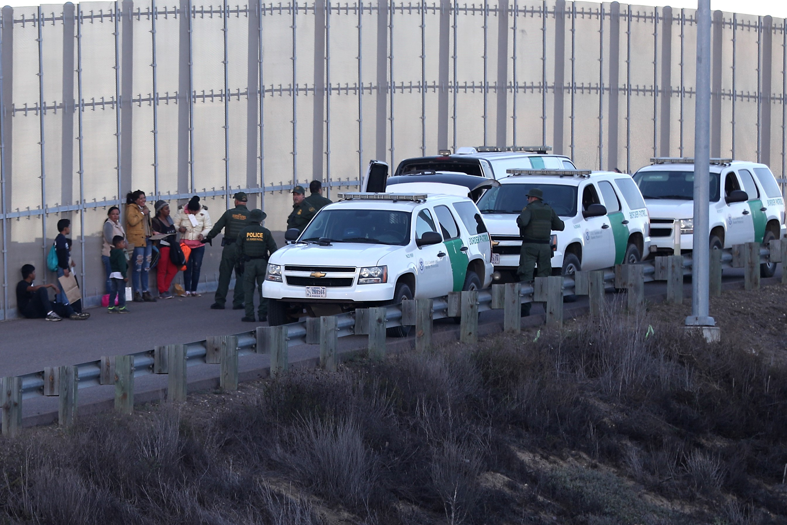 Migrants caught after crossing US-Mexico border