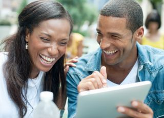 Close Up of Laughing Couple with Digital Tablet