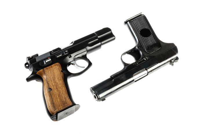 Close-Up Of Guns On White Background