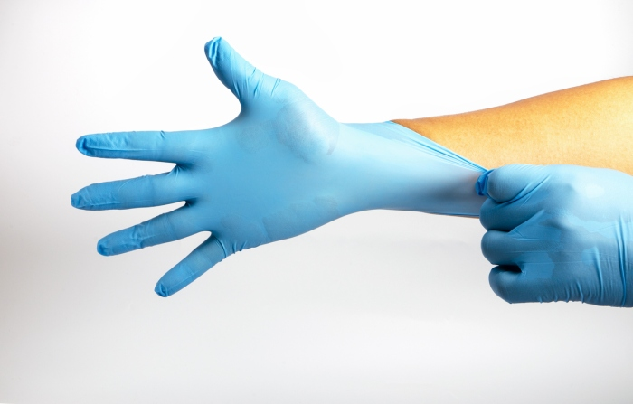 Human holding Variation of Latex Glove, Rubber glove manufacturing, human hand is wearing a medical glove, glove, isolated