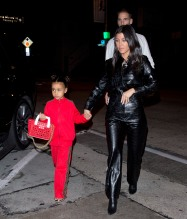 North West wears red Fendi sweatsuit to dinner with mom Kris Jenner Kourtney Kardashian and Corey Gamble