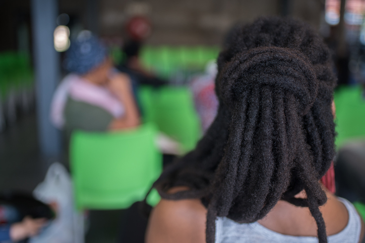 Rear View Of Woman With Dreadlocks