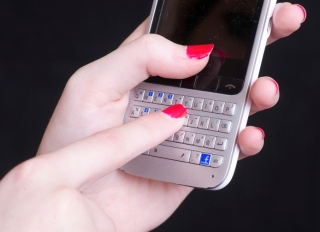 Young Woman Using Cell Phone, Close Up Of Hands